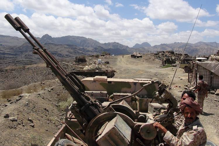 Southern People's Resistance militants loyal to Yemen's President Abd-Rabbu Mansour Hadi man an anti-aircraft machine gun that the militia seized from the army in al-Habilin, in Yemen's southern province of Lahej, on Sunday.