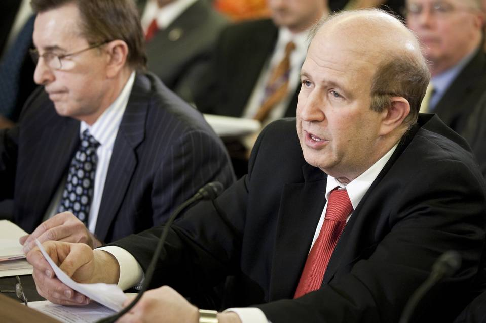 Harold Geisel, right, speaks during a congressional hearing in November 2010 while he was the State Department's acting inspector general.