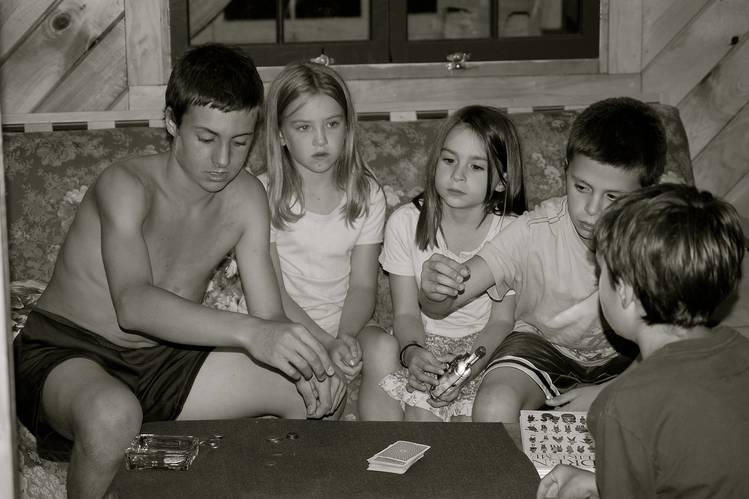 The Brett children, with a cousin, played cards in Vermont in 2007.