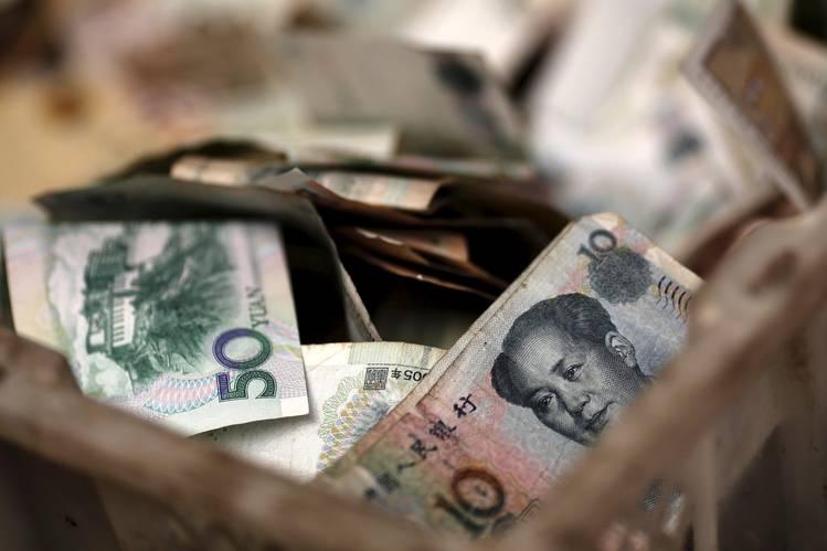 Yuan in a vendor's cash box at a market in Beijing.