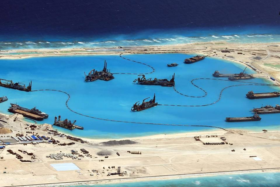 A handout picture made available by the Armed Forces of the Philippines (AFP) Public Affairs Office shows Chinese construction on a reef  in the disputed Spratly Islands in February.