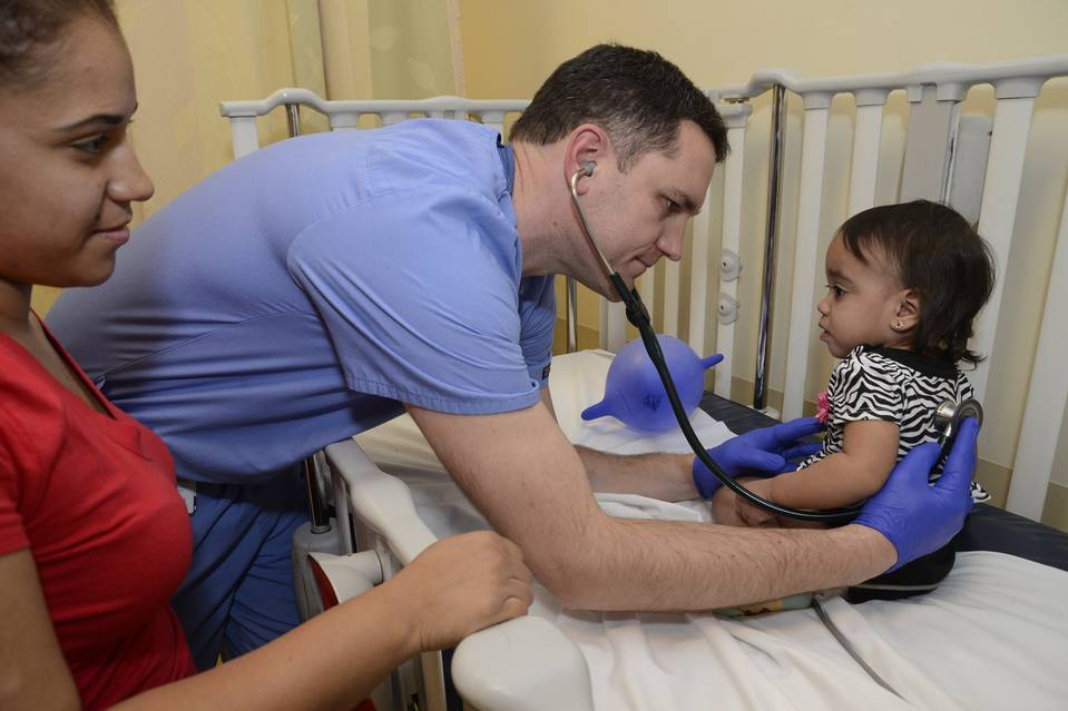 Dr. Joseph Faccio examines 14-month old Jailynn Rodriguez at Our Lady of Lourdes hospital in Camden, N.J. Her mother, Jessica Soto, brought her in for symptoms of fever and congestion.