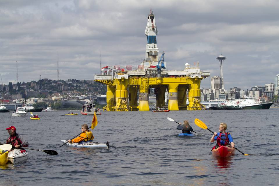 Environmental activists in kayaks protest the arrival of the Polar Pioneer oil drilling rig on Thursday in Seattle.