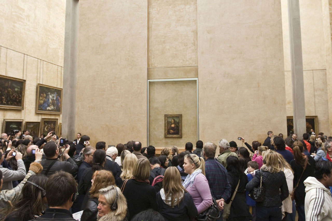If there is a ground zero for summer tourism, it may be the Mona Lisa, whose smile seems less mysterious than long-suffering when viewed against the constant crush of tourists around her. As many as 40,000 people rush the picture every day at the Louvre, according to the Paris museum.