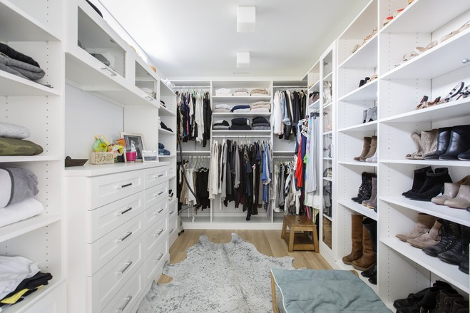 Ms. Periello is a stylist who does wardrobe consulting, so a closet (this is the master bedroom closet) that could keep belongings efficiently was important to her. The couple used a California Closets system instead of custom-made cabinets to save money.