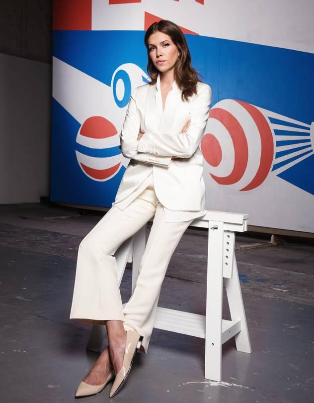 Garage founder Dasha Zhukova before a work commissioned from Russian painter Erik Bulatov.