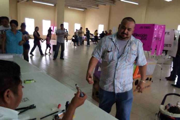 Restaurant worker Rolando Diaz, 33, casts his vote in La Cima, a working-class neighborhood in the northern city of Monterrey.