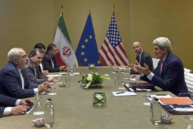 U.S. Secretary of State John Kerry, right, talks to Iranian Foreign Minister Mohammad Javad Zarif on May 30 in Geneva.