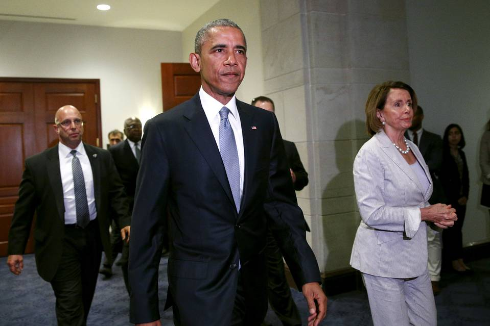 President Barack Obama, with House Minority Leader Nancy Pelosi, made a rare, unannounced visit to Capitol Hill to urge Democrats to support the trade bill.