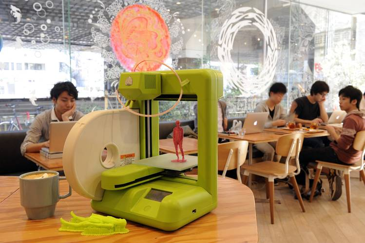 Customers sit at FabCafe, a 3-D-printing cafe in Tokyo.