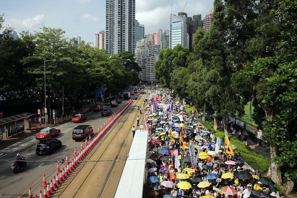 Pro-democracy marchers on the move on Hong Kong's annual day of protest; organizers estimated this year's turnout at 48,000.