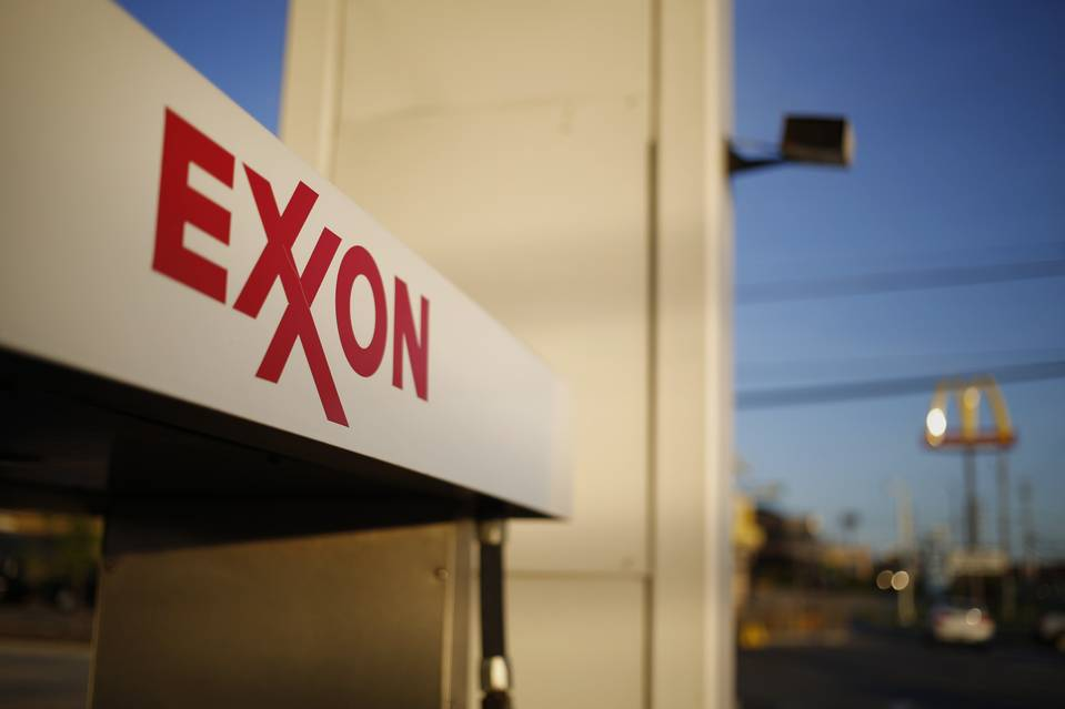 Exxon has moved to conserve cash in a sign that it doesn't expect a quick rebound in crude prices.