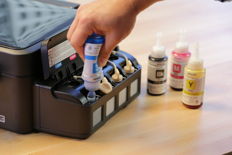 Instead of regularly replacing cartridges, you fill up the ink reservoir of an EcoTank printer.