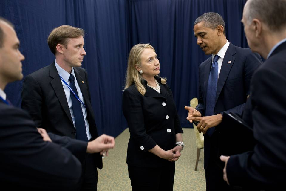 President Barack Obama talks with then-Secretary of State Hillary Clinton, center, and her top aide, Jake Sullivan, to her left, in Cambodia in 2012.