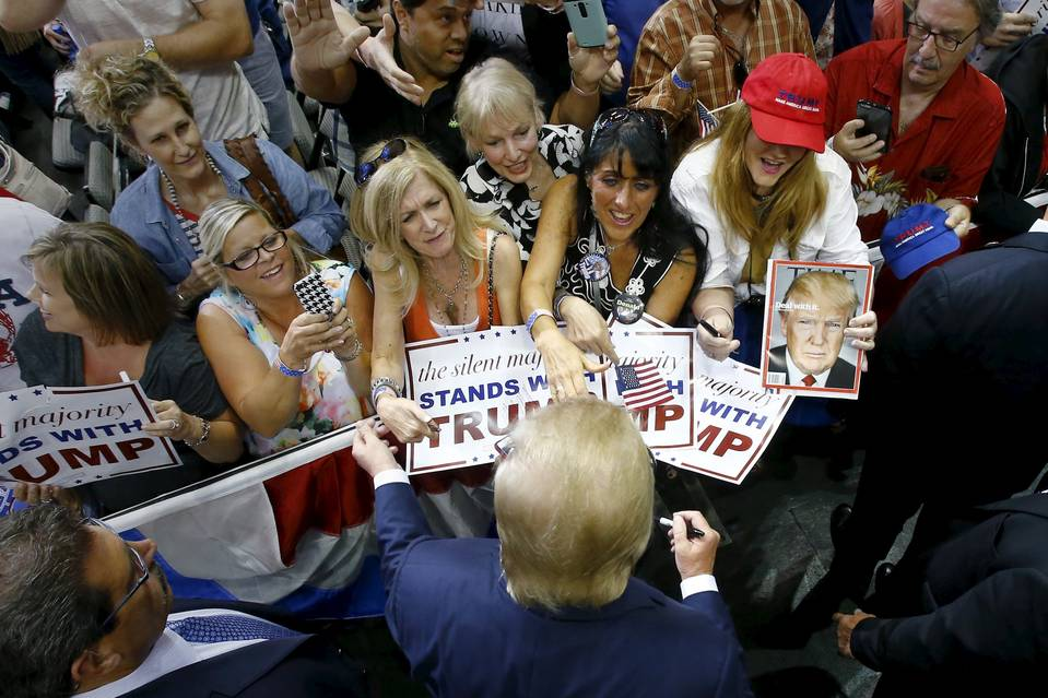 Republican presidential candidate Donald Trump works a crowd in Dallas on Sept. 14. His standing with women has slipped since then.