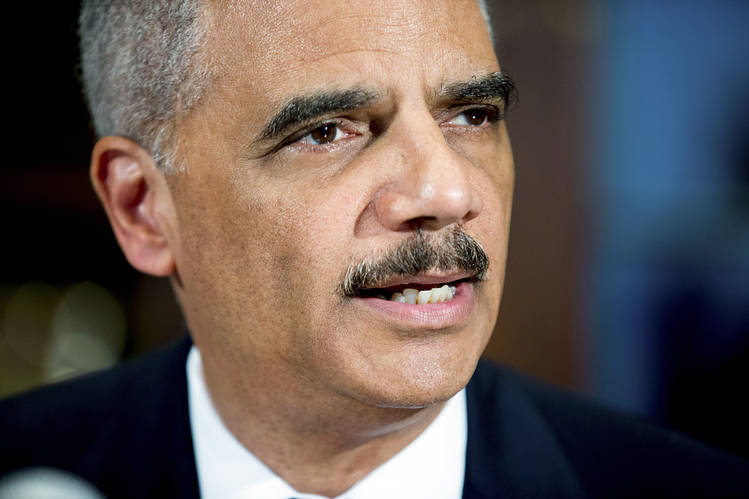 U.S. Attorney General Eric Holder in March; he left the Justice Department the following month.