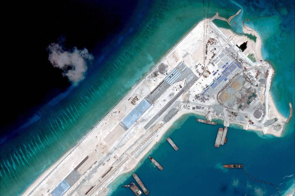 An April photo released by the Asia Maritime Transparency Initiative department at the Center for Strategic and International Studies think tank shows a satellite image of what is claimed to be an airstrip under construction at Fiery Cross Reef in the disputed South China Sea.