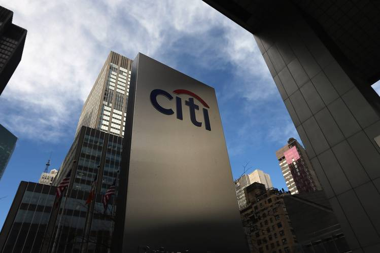 Citigroup's third-quarter per-share earnings beat analysts' latest expectations. Above, a sign near Citibank headquarters in Manhattan in 2012.
