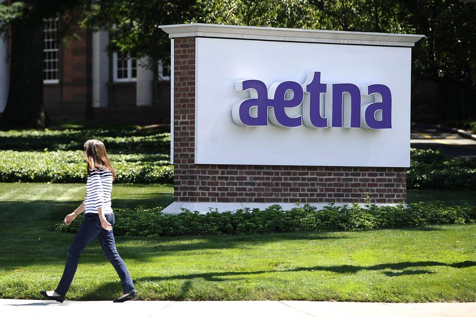 Aetna cited disciplined pricing and continued moderate medical cost trends for the drop in the company's key medical-benefit ratio.