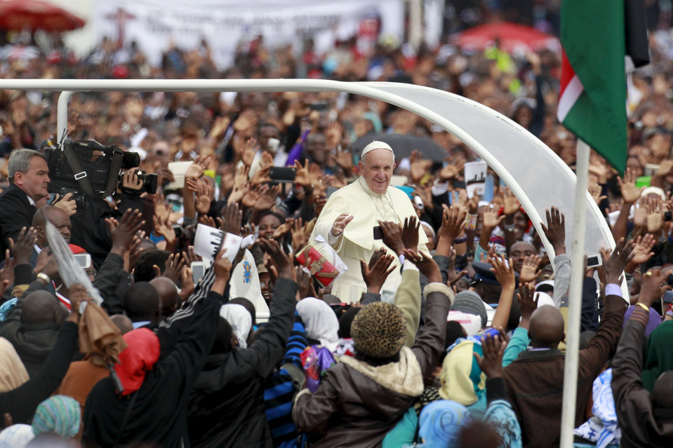 Pope Francis waves to faithful as he arrives for a Papal mass in Nairobi. Africa is recognized as being crucial to the future of the Catholic Church with the continent's Catholic numbers growing faster than anywhere else in the world.