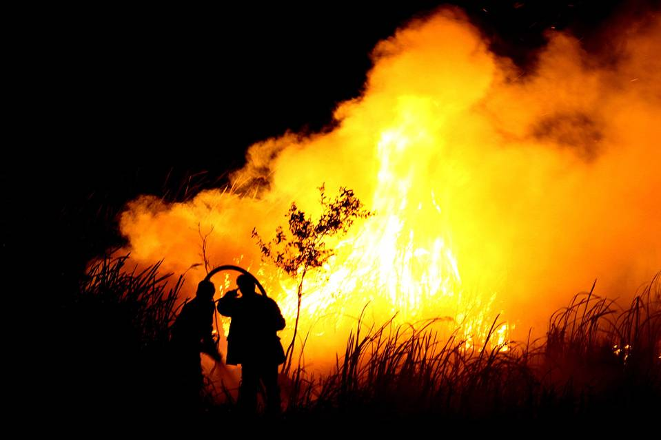 Indonesian men put out a fire in Ogan Ilir, southern Sumatra. The country has moved up the global list of greenhouse-gas emitters.