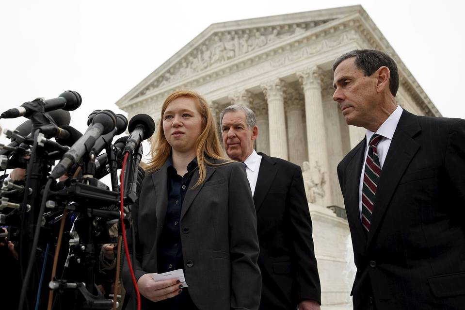 Plaintiff Abigail Fisher speaks outside the Supreme Court in Washington on Wednesday.