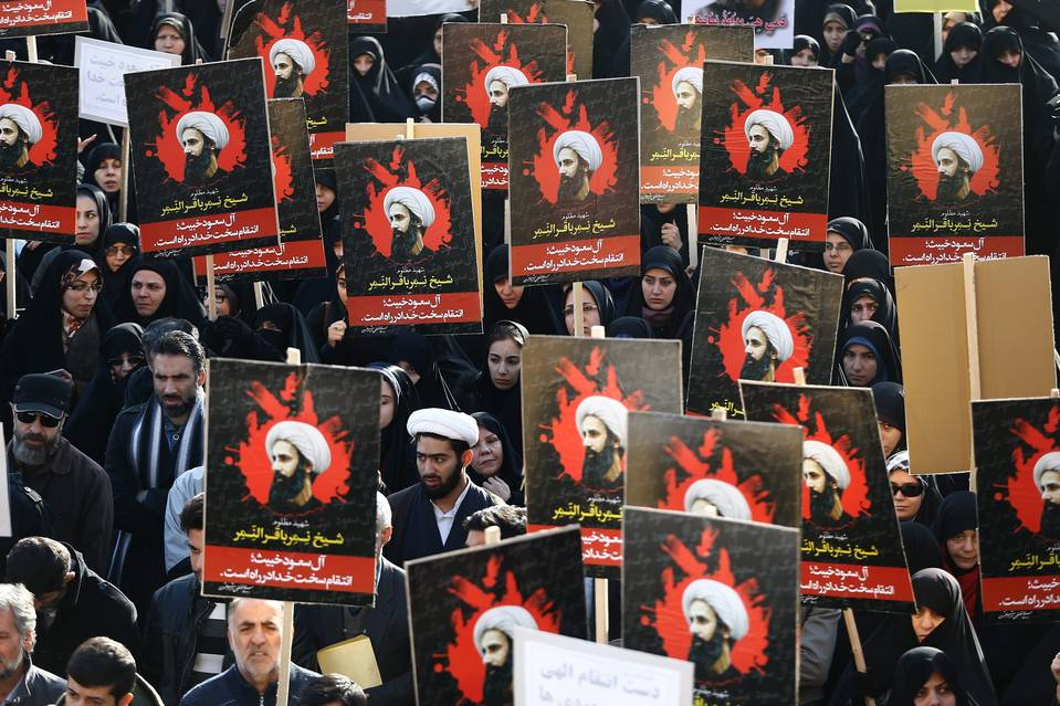 Iranians hold posters of Shiite cleric Nemer al-Nemer during an anti-Saudi Arabia demonstration at the Imam Hossein square in Tehran on Monday. Saudi Arabia cut diplomatic ties with Iran on Sunday following Saudi Arabia's execution of the Shiite cleric on Saturday.