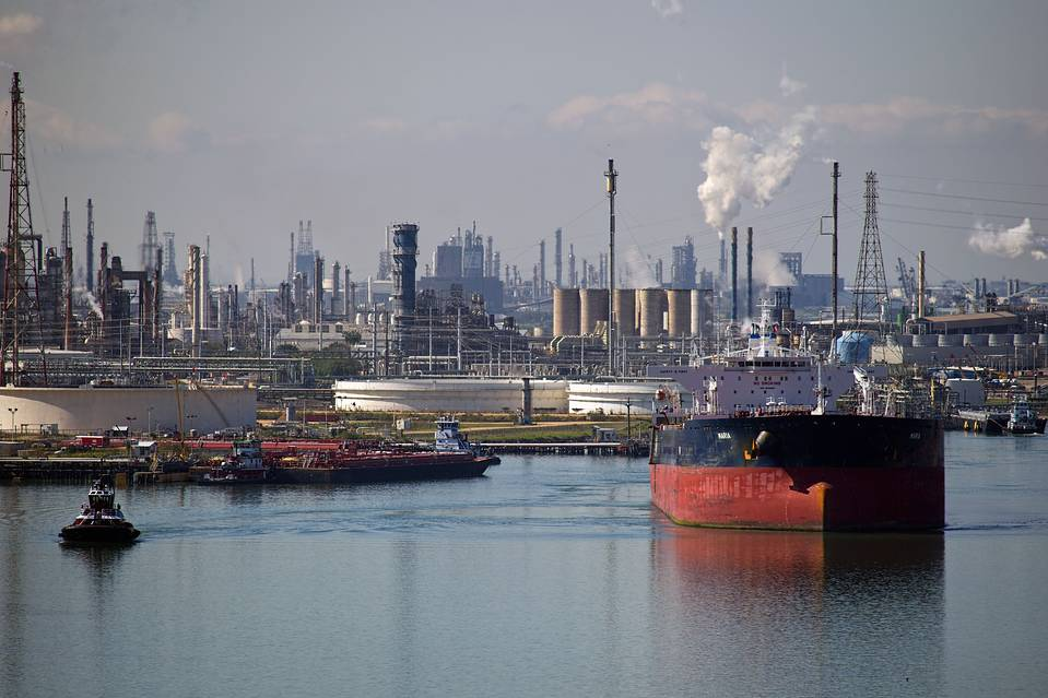 A tanker leaves an oil refinery in Corpus Christi, Texas, earlier this month. The benchmark price of U.S. crude tumbled more than 5% to $31.41 a barrel on Monday, setting a 12-year low.