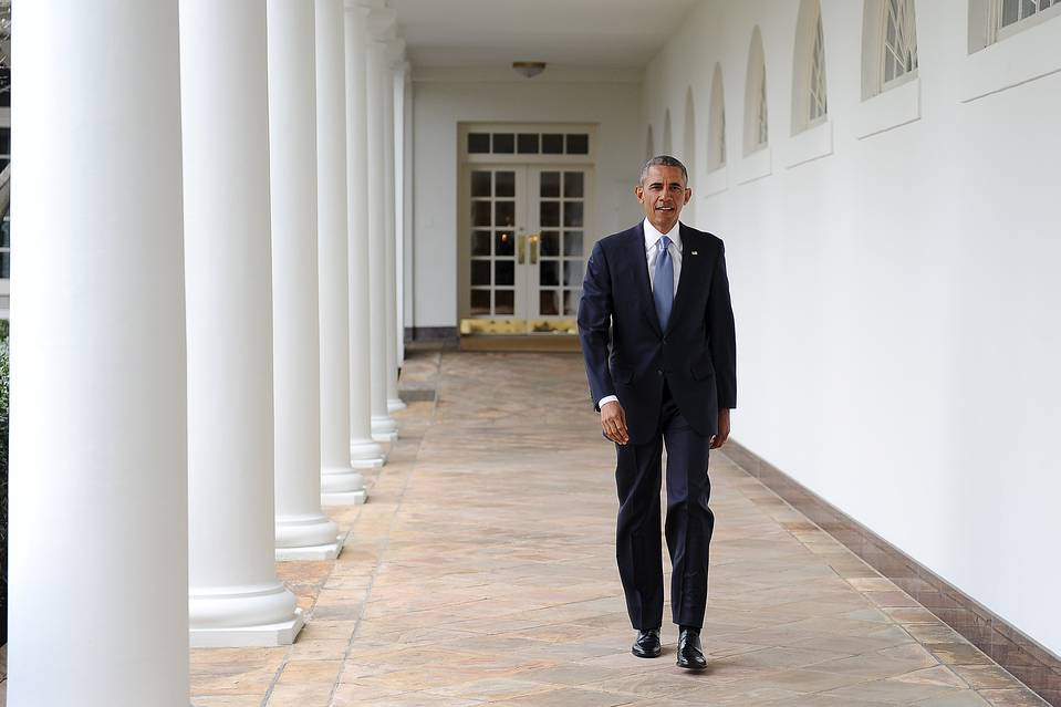 U.S. President Barack Obama walks down the colonnade from the Oval Office at The White House in Washington on January 12.