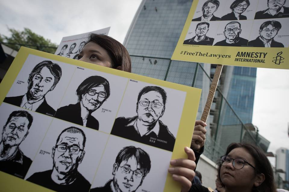 Activists protest outside the Chinese embassy in Bangkok on August 6, 2015. Amnesty International staged a protest outside the Chinese embassy to demand the release of over 200 human rights lawyers and activists in China.