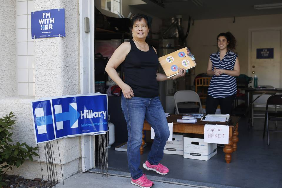 Cynthia Ameli, a Chinese-American, picks up materials to canvass for Hillary Clinton in Las Vegas.