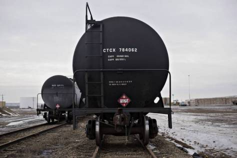 Rail tanker cars sat on tracks at the Red River Supply Inc. rail yard in Williston, N.D., in February 2015.