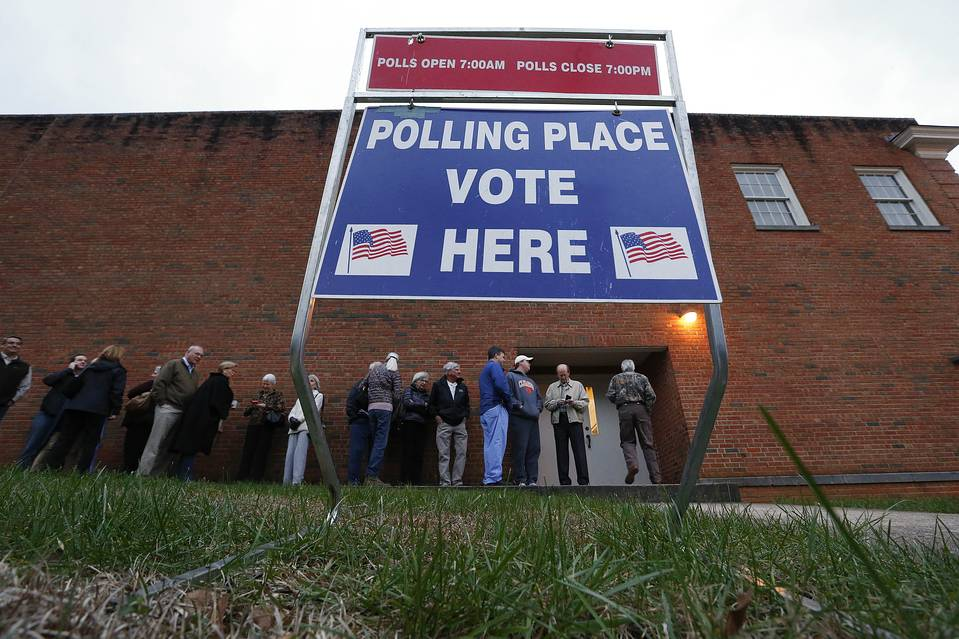 Voters wait in line for a polling place to open at Eastlan Baptist Church Feb. 20 in Greenville, S.C.