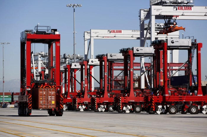 Cargo containers are carried around the TraPac marine terminal at the Port of Los Angeles by automated machines guided by a magnetic grid embedded in the pavement.