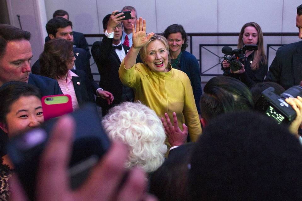 Democratic presidential candidate Hillary Clinton waves as she exits the room forllowing her address the Asian Pacific American Institute for Congressional Studies (APAICS) reception in Washington May 4.