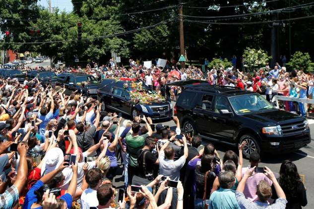 A hearse carrying Ali's body enters Cave Hill Cemetery in Louisville.