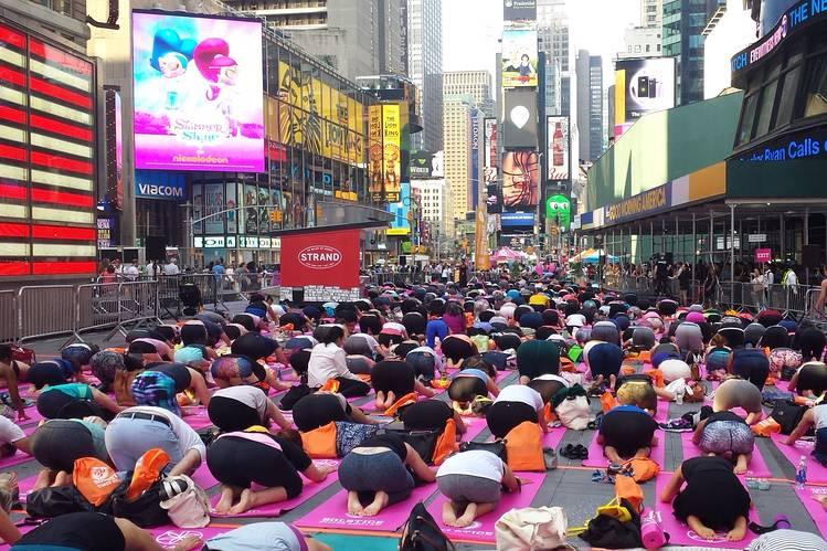 People performed yoga exercises at Times Square in New York city Monday.