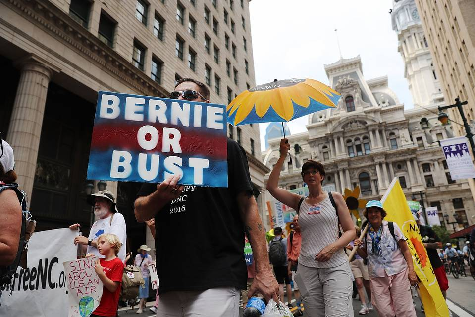 Hundreds of environmentalists and Bernie Sanders supporters march through downtown Philadelphia on July 24, a day before the start of the Democratic National Convention.