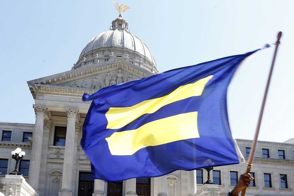 The Human Rights Campaign's flag, the largest national lesbian, gay, bisexual, transgender and queer civil-rights organization, is waved on the steps of the Mississippi Capitol in Jackson, Miss., on July 1.