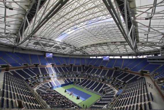 A new retractable roof allows a ribbon of light into Arthur Ashe Stadium at the Billie Jean King National Tennis Center in Queens on Tuesday.
