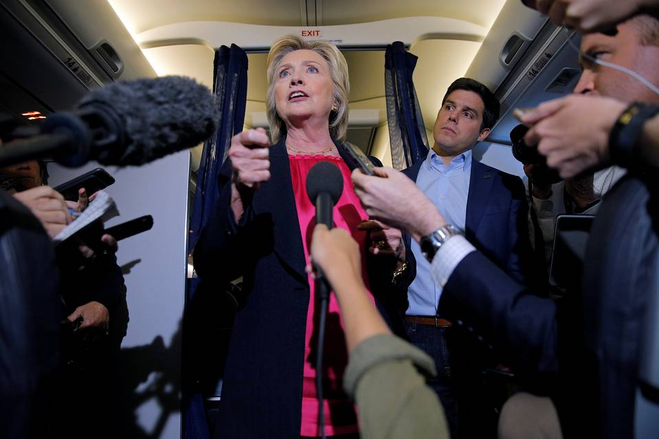Hillary Clinton answers a question from a reporter on her campaign plane enroute to Tampa, Fla., on Tuesday.