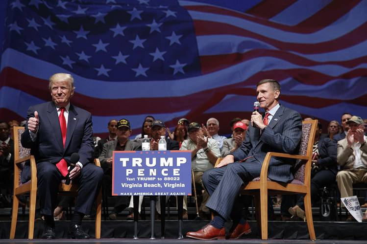 Republican presidential nominee Donald Trump gives a thumbs-up as he speaks with retired Lt. Gen. Michael Flynn during a town hall Sept. 6 in Virginia Beach, Va.