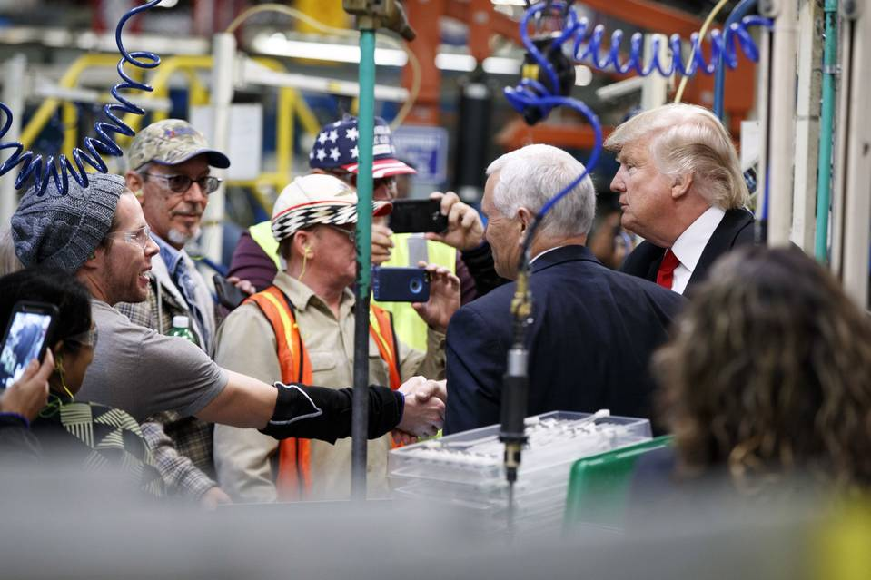 Donald Trump and Vice President-elect Mike Pence talk with factory workers during a visit to the Carrier factory on Thursday.