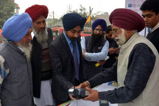 A visitor uses his thumbprint to try a system to withdraw money from his bank account using his Aadhaar identification card at an event promoting digital payment in Amritsar, India last week.