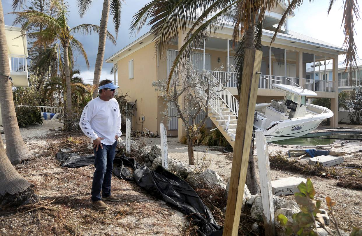 Homes Built to Stricter Standards Fared Better in Storm   WSJ A man surveys damage to a home in Duck Key  Fla   after Hurricane