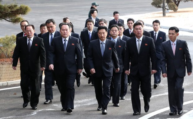 The head of North Korean delegation, Ri Son Gwon, second left in front, arrives for talks in the demilitarized zone Tuesday.