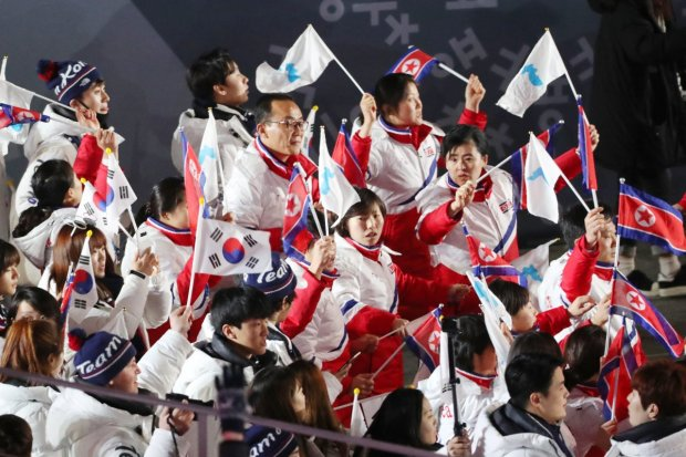 South Korea and the U.S. postponed annual springtime military exercises until after the Olympics and Paralympics. Here, South and North Korean athletes march during the Olympic Closing Ceremony.
