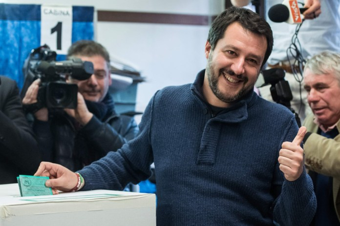 Lega Nord far right party leader Matteo Salvini pushes a thumb up as he votes for general elections on March 4, 2018 at a polling station in Milan. Italians vote today in one of the country's most uncertain elections, with far-right and populist parties expected to make major gains.