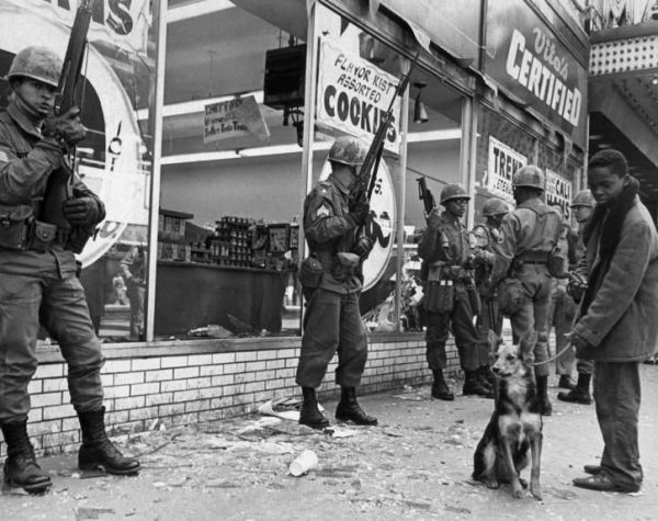 Violence broke across American cities after the April 4, 1968 assassination of Martin Luther King Jr. Above, soldiers stand guard in front of a supermarket on Chicago's South Side three days later.