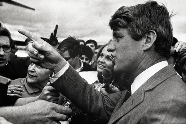 Senator Robert F. Kennedy's assassination on June 5 further traumatized the country. Above, he campaigns in Portland before the May 28 Oregon primary.